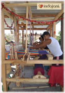 The Uncles busy on a foot pedal loom