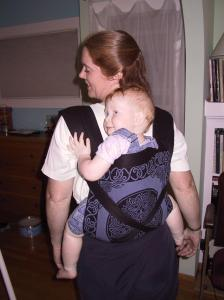 Holly of BWI Bay Area wearing her baby in a Mei Tai