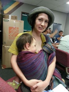 Nursing in a Rebozo carry at a meeting with City Council