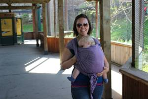 Emily an educator with BWI Bay Area nursing in a Kangaroo Carry