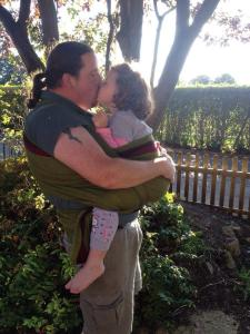 Slingdad Dom sharing some kisses with his daughter