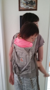 This 3 year old is being worn comfortably, she is all the way down in the seat, no slack in the shoulder straps.