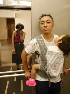 Proud papa with a sleeping toddler in a Tokyo elevator